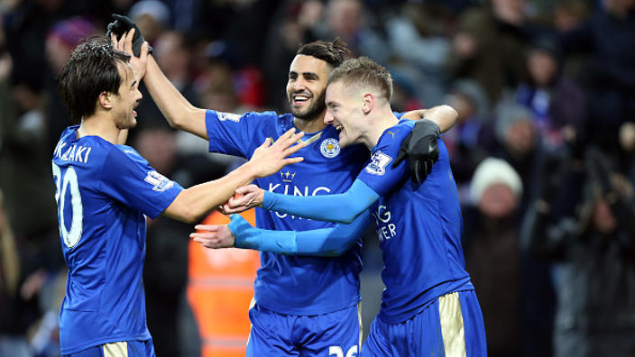 LEICESTER, ENGLAND - FEBRUARY 02 : Jamie Vardy of Leicester City celebrates with Shinji Okazaki and Riyad Mahrez of Leicester City after scoring to make it 2-0 during the Barclays Premier League match between Leicester City and Liverpool at the King Power Stadium on February 02 , 2016 in Leicester, United Kingdom. (Photo by Plumb Images/Leicester City FC via Getty Images)